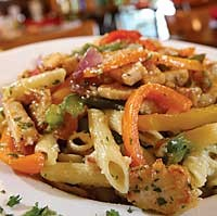 Pollo Pepperonata: Chicken strips, tri-colored peppers, red onions, olive oil and garlic served with penne pasta. - MT PHOTO: ROB WIDDIS