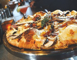 Portobello mushroom pizza with roasted garlic, bacon, and fontina cheese, from Amici's in Dearborn. - MT PHOTO: ROB WIDDIS