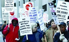 Protesters outside the federal courthouse during Detroit's bankruptcy trial.