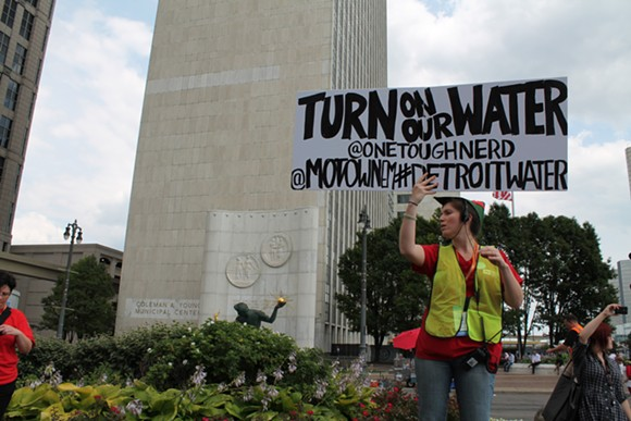 Demonstrator during a protest last year in opposition to water shut-offs in Detroit. - MT FILE