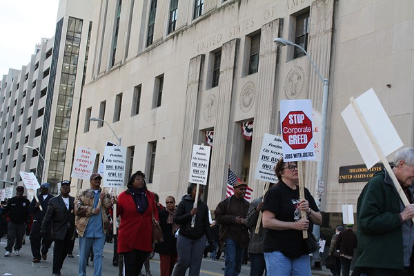 Retirees and supporters gathered outside of the Theodore Levin federal courthouse in downtown Detroit on Tuesday, April 1, to protest Detroit Emergency Manager Kevyn Orr's proposed bankruptcy-exit plan, which calls for cuts to monthly pension checks. - PHOTO BY RYAN FELTON.
