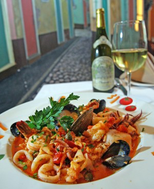 Risotto Marinara: Shrimp, scalops and mussels in a red clam calamari sauce, served over a bed of rice. - MT PHOTO: ROB WIDDIS