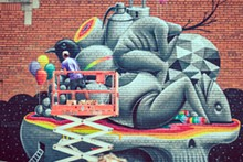 SAL RODRIGUEZ - Rodriguez photographs the artist Okuda working in Eastern Market