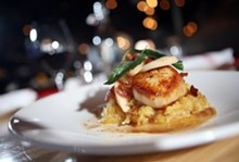 Sautéed sea scallops with spaghetti squash, smoked apples, bacon, brown butter and sage, from the Meeting House in Rochester. - ROBERT WIDDIS