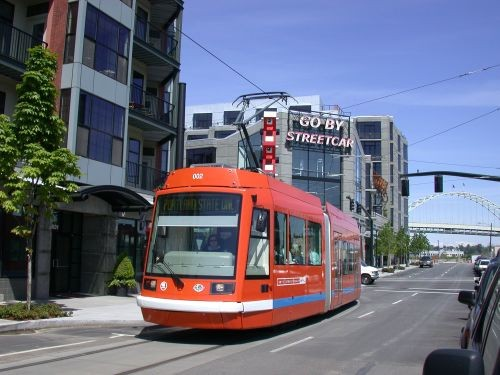 The Portland Streetcar, with a route of 7.35 miles, has 70 stops. The proposed M1 transit line connecting downtown to Midtown and New Center could employ a similar concept.