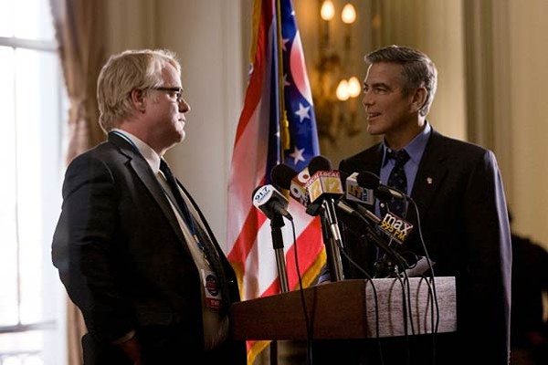 The suit makes the - man: Philip Seymour Hoffman and - George Clooney in Ides of March.