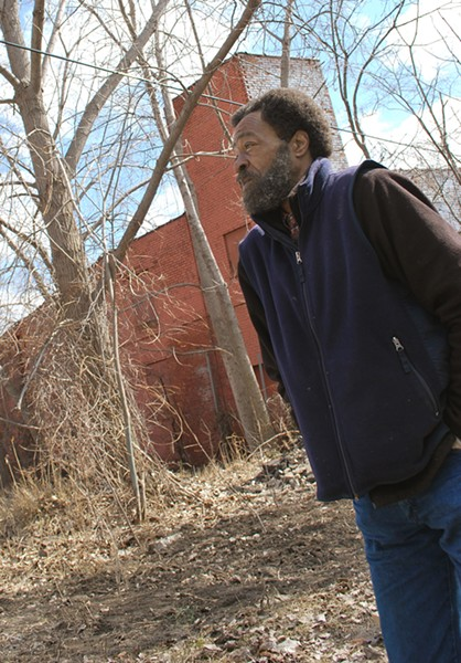 Tom Bell in the yard of his home. - PHOTO: DETROITBLOGGER JOHN
