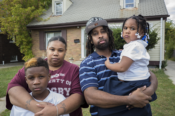 Shakiya Robertson stands in front of her foreclosed house with her husband Warren and two of their kids Kye'Ren and Kyi'Lei. - IAIN MAITLAND