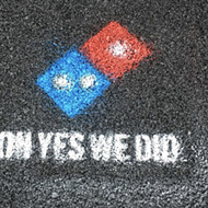 Domino's Pizza is paving the nation's potholes,  but not Michigan's