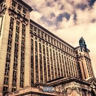 See what Drake looks like sitting on Detroit landmarks