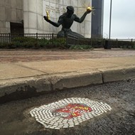 Chicago street artist turns Detroit pothole into a work of art