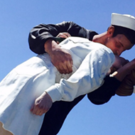 Nine reasons to cheer on the 25-foot-tall statue of a sailor and nurse