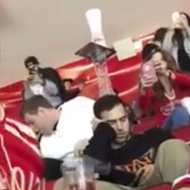 VIDEO: These Red Wings fans made an epic cup tower on a sleeping fan's head