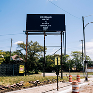 Adeshola Makinde's 'Relevant' highlights civil rights protest signs of past and present at Playground Detroit