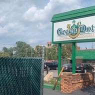 Court orders fence built in Detroit's Green Dot Stables parking lot removed