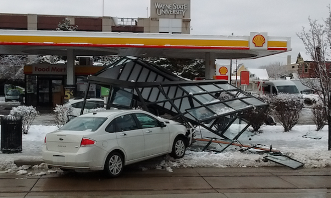 A car careened across Woodward Avenue in February and shattered a bus shelter at Forest. Thankfully, there were no serious injuries. - PHOTO BY MICHAEL JACKMAN