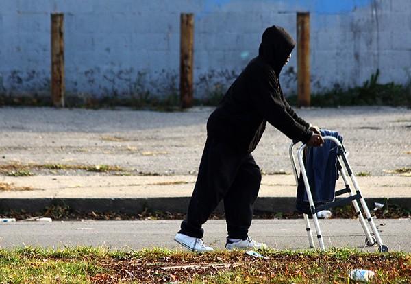 A man pushes a broken walker down Peterboro Street in Detroit. - JEFF SMITH, FLICKR