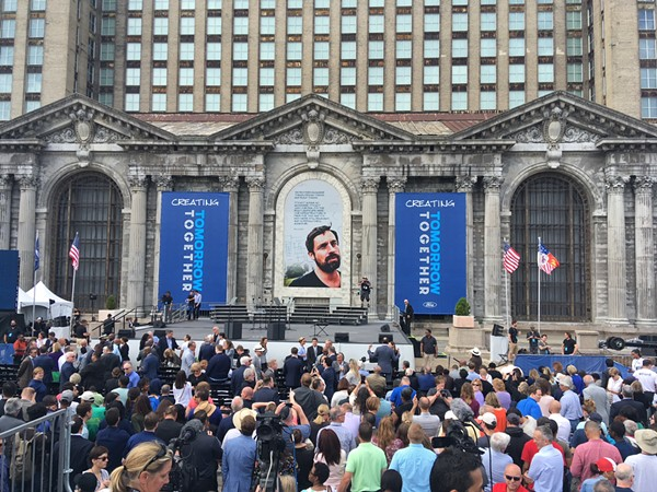 Ford Motor Co. celebrates its purchase of Detroit's long-abandoned Michigan Central Station. Yes, that is a photo of Phil Cooley. - LEE DEVITO