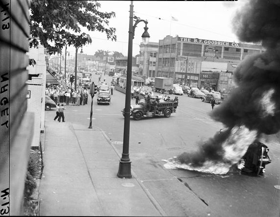 Detroit firefighters respond to a car fire on Woodward Avenue. - IMAGE USE COURTESY OF WALTER P. REUTHER LIBRARY, ARCHIVES OF LABOR AND URBAN AFFAIRS, WAYNE STATE UNIVERSITY