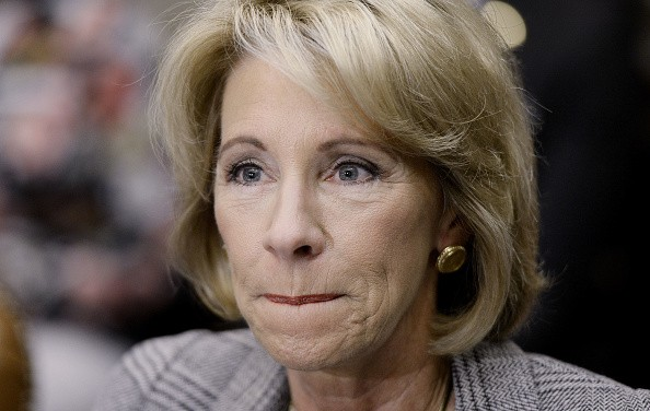 This person claims to run the Department of Education, but some say she's a puppet for the NRA. - SHUTTERSTOCK