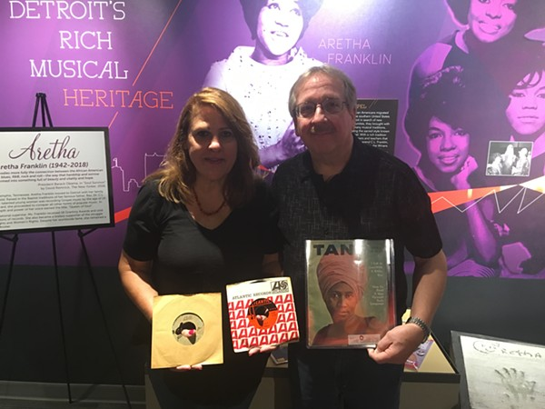 "Denise and Dan Zieja have loaned boxes of Aretha Franklin memorabilia to the Detroit Historical Museum. Denise holds the ""Respect"" test pressing in her right hand, and the final version in her left. - LEE DEVITO"