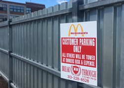 An apparently inaccurate warning at the McDonald's in Midtown. According to people who've been victimized by Breakthrough, even customers can get towed here. - VIOLET IKONOMOVA