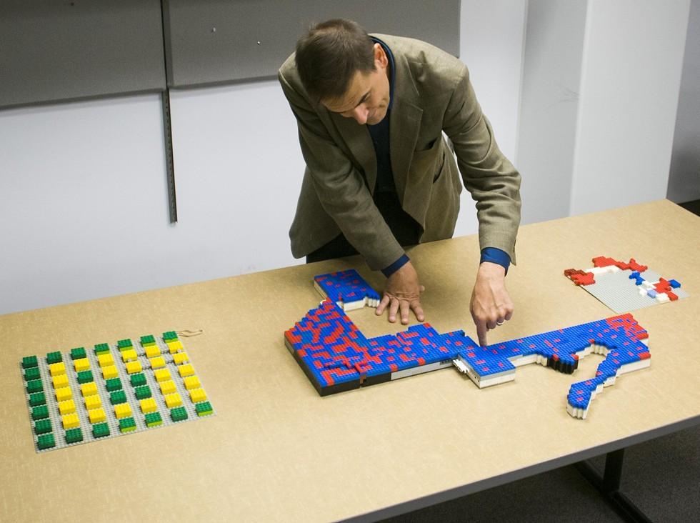 Wayne State University associate political science professor Kevin Deegan-Krause uses Legos to demonstrate gerrymandering. - TOM PERKINS