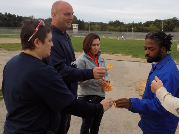 Jason Carr passes out ChadTough bracelets to inmates at Cotton. - COURTESY OF CHADTOUGH