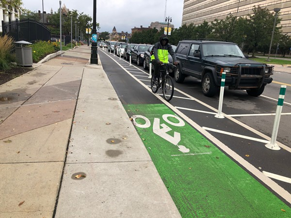 A man using one of Detroit's bike lanes, which Keith Crain believes nobody uses. - DEVIN CULHAM