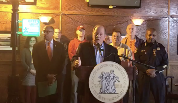 Mayor Mike Duggan announces the most recent expansion of the controversial Project Green Light to Corktown from inside McShane's Irish Pub - SCREENGRAB FROM DETROIT POLICE DEPARTMENT FACEBOOK LIVE