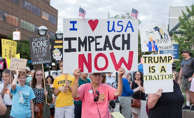 Demonstrators protested President Donald Trump in cities across the country in July following Trump's surrender to Vladimir Putin in Helsinki, Finland, including a contingent on the U-M campus in Ann Arbor. - KATIE RAYMOND