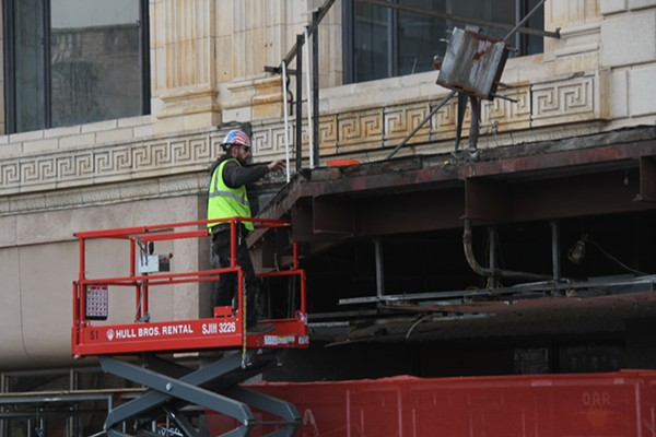 A construction worker removing the final pieces from the historic Fillmore marquee. - WILL FEUER
