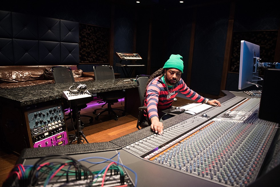 Icewear Vezzo works the 48-channel SSL console at Royal House Recording. - KAHN SANTORI DAVISON