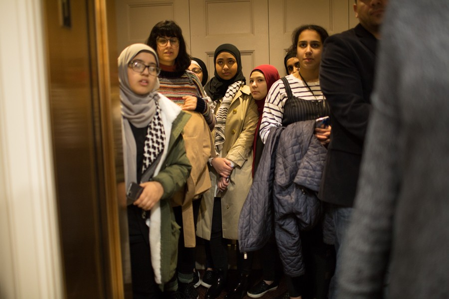 Youth squeeze into an elevator to the sixth floor on their way to Tlaib's office. - ERIK PAUL HOWARD