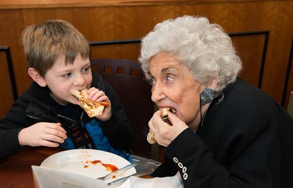 Olga Loizon snacking with a tiny human. - COURTESY PHOTO