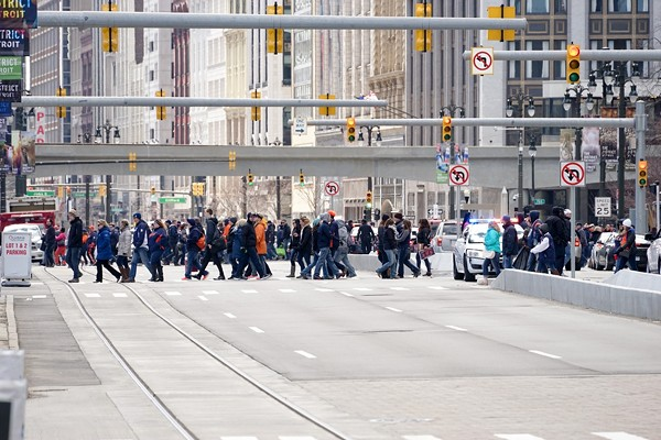 A crowd of pedestrians crossing Woodward Ave. in downtown Detroit. - TONY BENNETT/DETROIT STOCK CITY