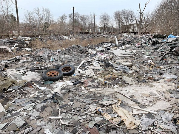 An illegal junkyard built by a Macomb County man in the North End neighborhood. - TOM PERKINS