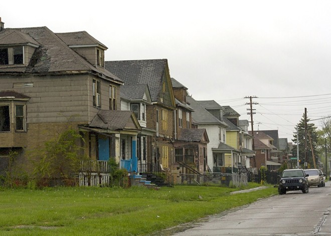 A row of dilapidated houses at Crane and Charlevoix on Detroit's east side. Eleven houses on this block have been foreclosed since 2002. - STEVE NEAVLING
