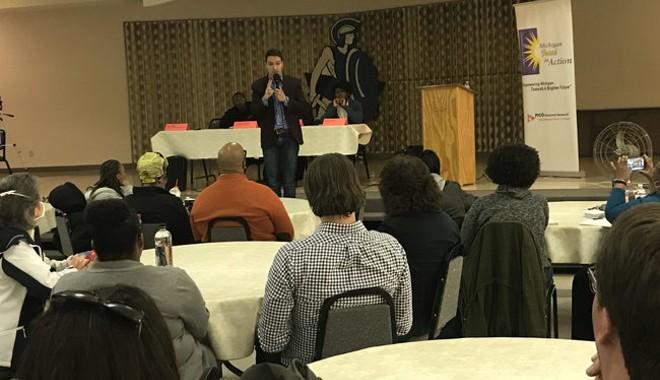 Igor Volsky with the group Guns Down America spoke at a town hall meeting Monday night in Flint. - SAM INGLOT/PROGRESS MICHIGAN