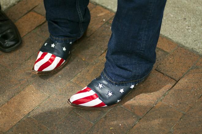 Charlie LeDuff's iconic boots. - STEVE NEAVLING