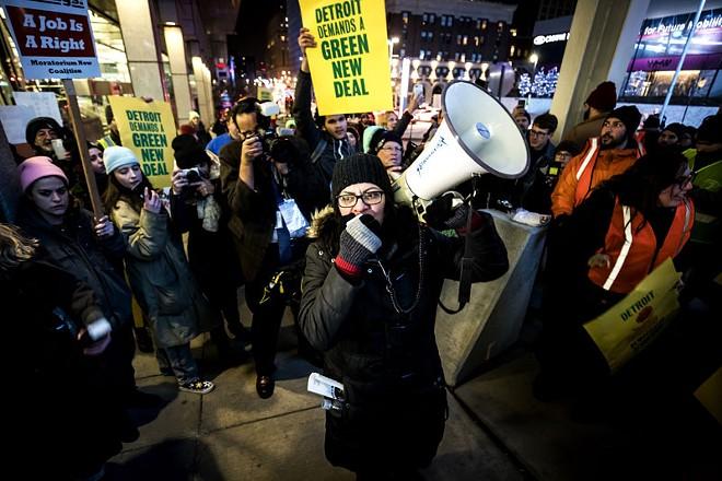 Detroit congresswoman Rashida Tlaib takes to the megaphone at a Green New Deal demonstration earlier this year. - JOSEPH XU