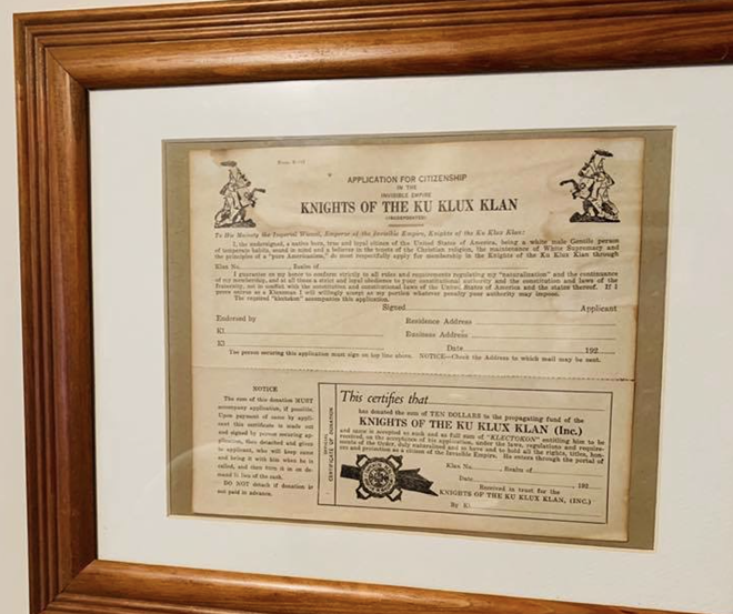 A framed Ku Klux Klan application form was left displayed in the house of a white Michigan police officer while a Black man was there with a real estate agent. - VIA ROB MATHIS' FACEBOOK PAGE
