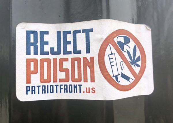 Patriot Front sticker along Woodward Avenue in Detroit. - STEVE NEAVLING