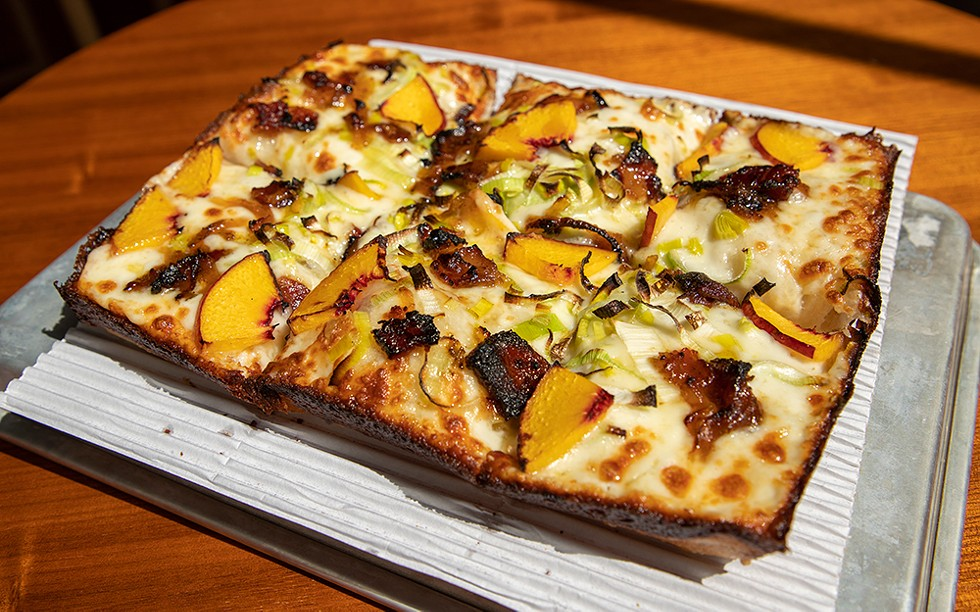 A new spin on an old classic: The Peach Pit from Michigan & Trumbull features peaches, leeks, bacon jam, and honey drizzle. - BRIDGET EKIS