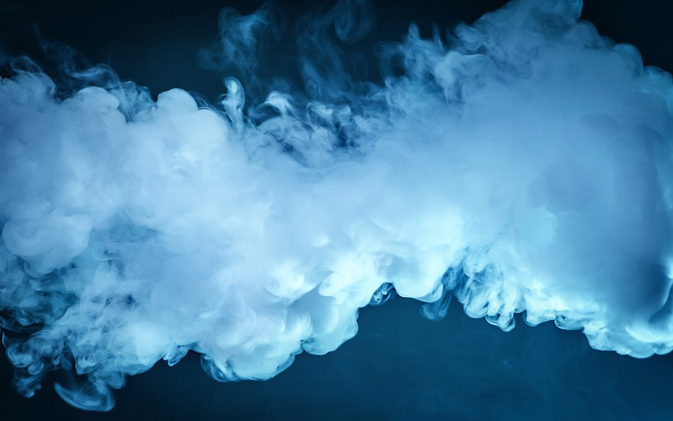 """Vaping was introduced to the U.S. mass market in 2007. The """"e-liquid,"""" which can come in fruit or candy flavors, is heated up with a battery-powered device, creating thick, white vape clouds when exhaled. - SHUTTERSTOCK"""