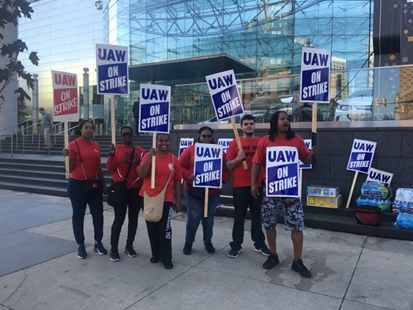 Workers on strike outside of GM's Detroit headquarters. - LEE DEVITO