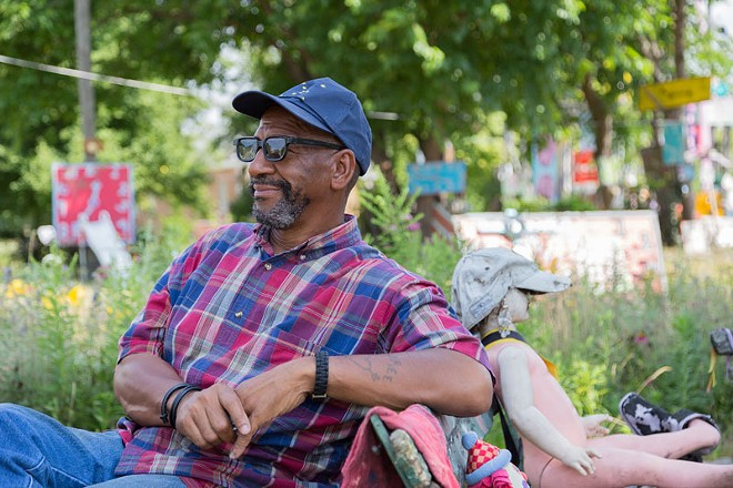 Tyree Guyton at his creation, the Heidelberg Project. - TIM JOHNSON