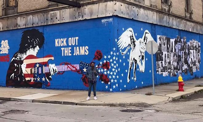 Artist Gabe Gault painted an MC5 mural at the Grande Ballroom. - ZAK WARMANN