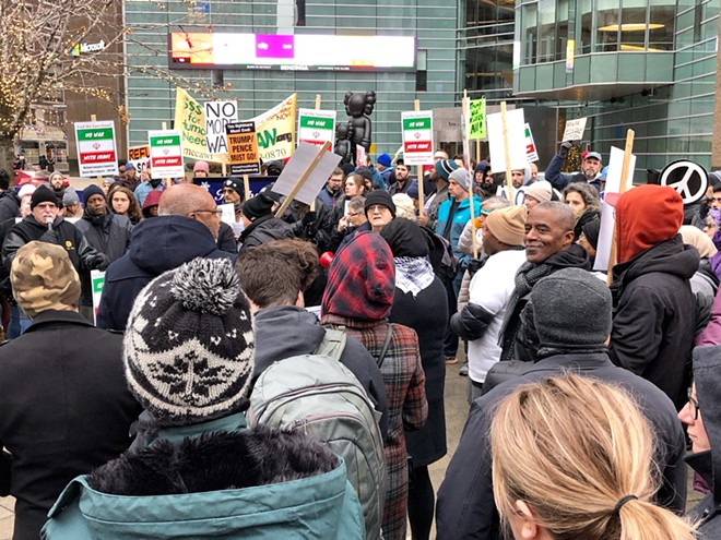 Anti-war protesters gathered in Detroit on Saturday. - STEVE NEAVLING