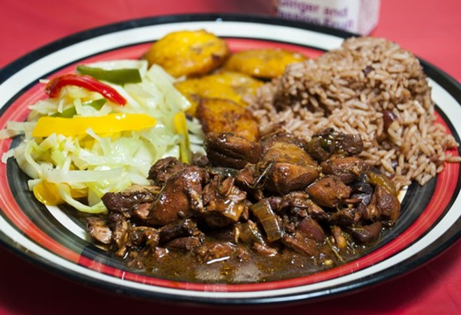 Brown stew chicken at Jamaican Pot. - TOM PERKINS